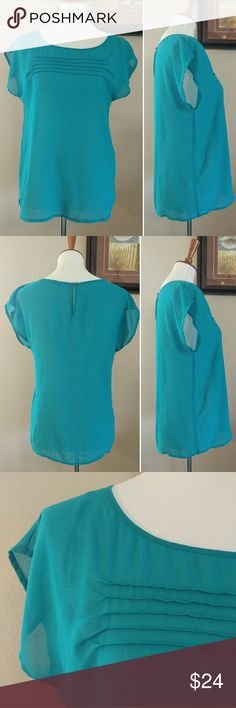Zara Basic Women's SZ S Teal Sheer Blouse Zara Basic women's size small teal sheer short sleeve blouse. Back has a keyhole button enclosure. Top is gently used with no flaws. Fast shipping - same or next business day. Thanks!  Measurements  Armpit to armpit: 18 inches Length: 24 inches Zara Tops