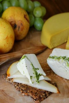 Basil Pesto Almond Cheese (vegan) - This cheese is mild and creamy, with a soft texture that is light and easily spreadable. The tangy basil pesto adds a punch of bold flavor, and leaves a slight citrus finish. #Recipe #Vegan #Cheese