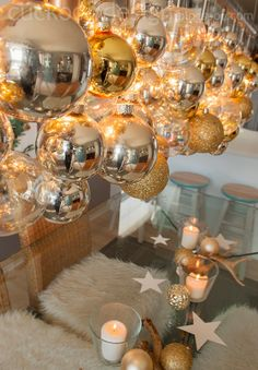 I like the cluster of ornaments on the light fixture and the simple table decor. Blogger Stylin Christmas Home Tour 2013
