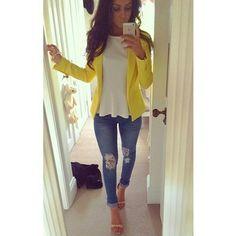 Yellow blazer, skinny jeans and heels.