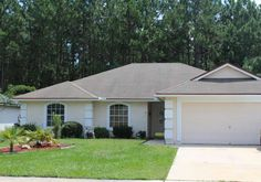 LOCATION, LOCATION, LOCATION. Best ... priced pool home in the Lake Asbury area.  4 Bedrooms 2 Bathrooms in this open floor plan plus a seperate office.  Dining Room and Kitchen are open to Family room which is a perfect set up for entertaining or family events.  Enjoy the large in ground pool just outside of the family room patio doors. This is a preserve lot so backyard is private. New wood floor and and a seperate office are a plus! Great Clay County Schools close by!