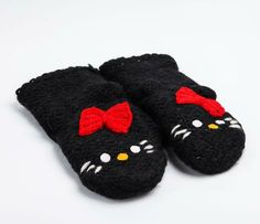 Hello Kitty Knit Mittens: Black. I have these AND I got them on sale. Meow.