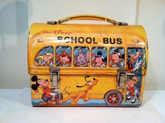 I wanted this lunch box, but never got it.  Walt Disney Bus Domed Top Metal Lunch box