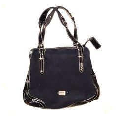 The Sak Handbag This patent leather and suede bag is well constructed with detail after detail. Patent leather handles , sides , and bottom . Inside has invisible magnetic closure and two zipper pockets. The Sak Bags Shoulder Bags