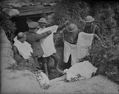 cidre-de-glace:     Canadians being issued with summer underwear in reserve trenches. June, 1917.