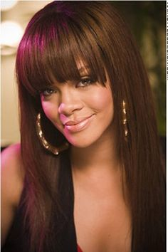 Rihanna looks very hot and sultry with this sexy hairstyle. Her hair is completely straight with long bangs just above eye level.This is a long hair cut with the sides of her hair cut rounded. The bangs are cut just above eye level.Her hair colour is a rich dark chocolate brown.