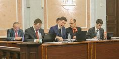 Pictured front, left to right: Anton Omelchenko, Maksim Novakov, Victor Zhenkov, and Yury Toporov, attorneys for the Administrative Center of Jehovah's Witnesses in Russia. Rear, left to right: Vasiliy Kalin and Sergey Cherepanov (in background), members of the presiding committee of the Administrative Center of Jehovah's Witnesses in Russia. Courtesy of Jehovah's Witnesses