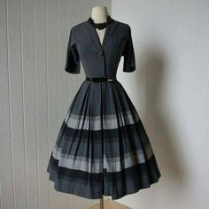 I really like the sleeve style, small lapel, button, and multiple box pleats on this dress.