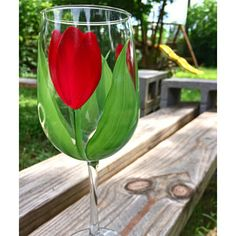 Deep pink and cream tulips with white highlights and deep green flowing leaves hand-painted encircling a quality ounce tumbler glass. White Highlights, Yellow Daisies, Pink Tulips, Hibiscus, Green Hydrangea, Limelight Hydrangea, Daisy, Olive Oil Bottles, Painted Wine Glasses
