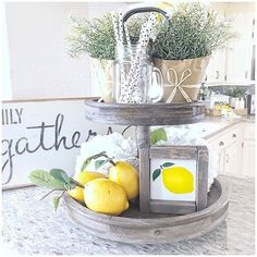Know what fresh lemons, cute potted plants, and distressed tiered trays make? Beautifully styled kitchen displays, like this one! Thx for sharing! Lemon Kitchen Decor, Kitchen Tray, Kitchen Display, Lemon Centerpieces, Centerpiece Decorations, Country Decor, Farmhouse Decor, Antique Farmhouse, Farmhouse Style