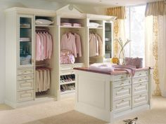 The gold accents in this ultra-femme closet looks luxe against the creamy white background.