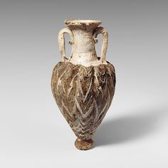 Glass amphoriskos (perfume bottle) Period: Classical Date: late 6th–5th century B.C. Culture: Greek, Eastern Mediterranean Medium: Glass; core-formed, Group I