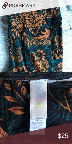 LuLaRoe Floral Tall and Curvy Leggings size 12-24 Beautiful and super soft LuLaRoe Tall and Curvy Leggings. Teal ish blue with an orangeish brown floral pattern. Black in background color as well. Never worn. New without tags LuLaRoe Pants Leggings