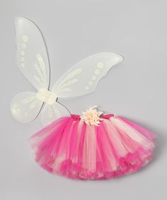 The biggest tea party in the history of Fairy City is only days away, and a girl has got to look her most fabulous to attend. This pixie pairing comes with a colorful tutu touting a crochet waistband and removable flower clip plus soft, stretchy wings that slip on comfortably over the shoulders.Fits ages 1 to 5 yearsIncludes tutu, wings and clip