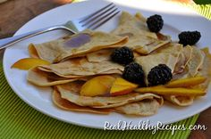 Swedish pancakes were my favorite breakfast while growing up. I'd enjoy a big stack of these thinly rolled cakes on my birthday every year. The best part was a big pat of fruit-spiked butter melting on top. Mmmmmm, pass the syrup. Naturally, I hacked this favorite recipe, leaving out the grains, gluten, dairy, and cane...