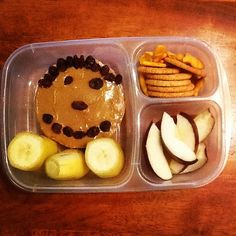 Lazy Bento morning rice cake with sunbutter, bananas, apples, crackers.