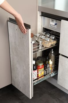 The wire basket drawer on the side of the cabinet provides excellent space for keeping the bottles and containers in place. Furniture Hardware, Home Furniture, Basket Drawers, Wire Baskets, French Door Refrigerator, Bottles, Household, Kitchen Appliances, Cabinet