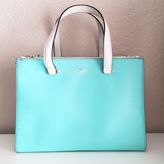 """Kate Spade Battery Park City Evalyn Bag Kate Spade Battery Park City Evalyn Bag. Brand new with tag and dust bag. Color in Tiffany Blue color, Freshair (141). Bag approx 10.5"""" x 14"""" x 5.5"""" The handle is 8.5"""". Lots of space with 2 zipper slots and open slot in between. I'm not in a rush to sell this beauty and may consider keeping it. No trade. All images are my own. kate spade Bags Totes"""