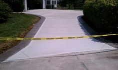 New concrete driveway with stamped border, Ofallon mo by T & H Foundations