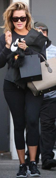 Khloe Kardashian: Sweatshirt and shoes – Nike  Sunglasses – Saint Laurent  Purse – Celine
