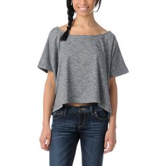 Get that boho vibe in the Bohemian knit shirt from Element. The allover heather black top is a boxy crop tee with a straight cut hem but a draped silhouette. The stretchy knit fabric is 25% organic cotton and super soft. With a wide scoop neckline, cropped fit, and wooden button details the Element girls Bohemian short sleeve knit top will keep you grounded and your summer fresh and fun!