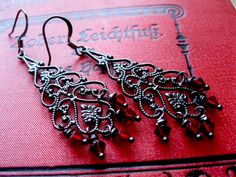 Lorena Gunmetal Black Gothic Chandelier Earrings with Blood Red Crystals True Blood inspired. £14.00, via Etsy.