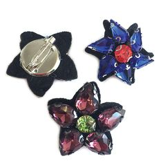 TWO GORGEOUS DIAMANTE FLORAL CRYSTAL PIN BROOCHES ONE IS A COBALT BLUE WITH A RUBY RED CENTRE; AND THE OTHER IS PLUM WITH AN EMERALD CENTRE. WEAR BOTH TOGETHER OR DOT THEM SEPARATELY ONTO BAGS SCARVES HATS. Button Jewellery, Jewelry, Red Centre, Scarf Hat, Aw17, Ruby Red, Winter Season, Cobalt Blue, Happy Shopping