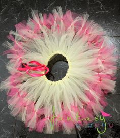 tutu can tie on scraps (look at the pink)  to the long pieces to make it look fuller without having to much tied onto the waist.