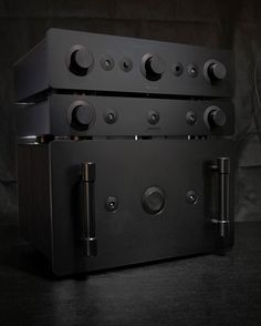 Sugden Masterclass series in custom Stealth finish. From the bottom: power amp, pre-amp, integrated amp