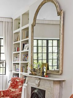 """Small Space, Big Items """"Oversize pieces give the illusion a room is larger. That's why I chose a giant mirror to put above the mantel; it draws your eye up to the ceiling. It's a little imperfect—it's actually scratched and broken in places—but to me that makes it more beautiful."""" Genevieve Gorder at Home"""