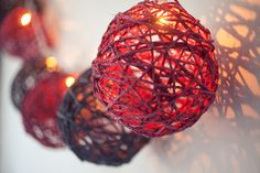 Globe String Lights Have you noticed those fancy string lights in the stores (even Target) can run $25 for one string? Pick up raffia balls at the dollar store, then string through white holiday lights. Done, for less than a couple bucks