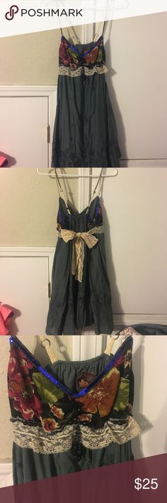 Free People Dress with beaded spaghetti straps Free people dress with beaded straps, lace tie around back. The dress is olive green with floral pattern up top Free People Dresses
