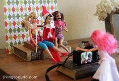 Elf On The Shelf: When your little elf arrives from the North Pole, he wastes no time celebrating with his long-lost Barbie friends! I wonder what Santa thinks of him using his beard as a prop? Shame on you, elf!