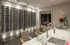 The unbeaten 40-year-old has been showing off the mansion's glass-fronted wine collection ...