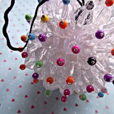 Step by step directions: Styrofoam ball, Clear faceted beads,Small colorful sparkle, and Head pins,
