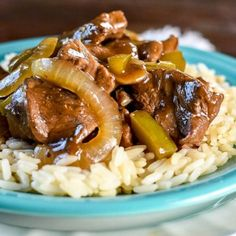 Beef Tips and Rice, with sauteed onions and peppers covered in a savory gravy, made in a dutch oven or crockpot, make an easy, delicious, and hearty dinner.