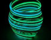 A Beautiful Piece  http://www.etsy.com/listing/90171184/glow-in-the-dark-glass-jar-j1