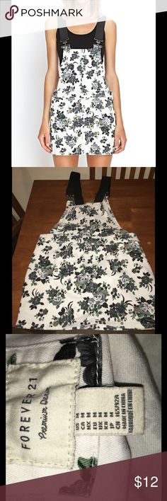 Forever 21 Medium Overalls Denim Dress Floral denim overalls dress.  Size medium. From Forever 21.  Excellent condition!   Important:   All items are freshly laundered as applicable prior to shipping (new items and shoes excluded).  Not all my items are from pet/smoke free homes.  Price is reduced to reflect this!   Thank you for looking! Forever 21 Dresses