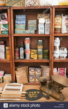 1940s replica grocers shop with packets of food and household items on the shelves