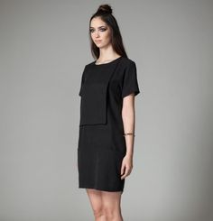 The Rainier by Jennifer Glasgow is a short sleeve tunic dress with inset pockets and asymmetrical overlaid square detail. Glasgow, Sustainable Fashion, Peplum Dress, Cold Shoulder Dress, Dresses For Work, Tunic, Collection, Black, Zipper