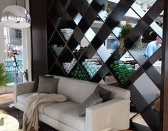 Wine wall separating the living room & kitchen - Jeff Lewis is a genius!