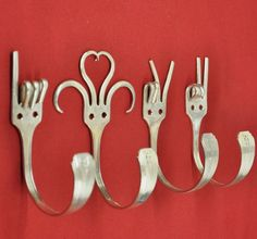 Forks as hangers in the kitchen. You can bend them the way you want, use any design you want, & they can hold towels easily!