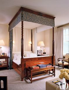 """The master bedroom, which has a Charles X bed, is """"the only room that's pretty much as it was when the building was constructed,"""" Kalla says. Circa 1850 English bench, Lee Calicchio. Ralph Lauren Home drapery fabric."""