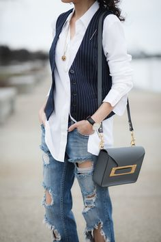 Kelly from Alterations Needed styles our navy and white pinstripe vest over a classic white button down oxford and pairs it with light wash distressed denim for a edgy street style look | Banana Republic
