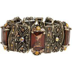 """Heirloom Finds Victorian Style Bracelet with Topaz Brown Gems Amber Champagne Crystal Accents Heirloom Finds. $26.99. Bracelet is 7"""" around and is 1 1/4"""" wide. Will Stretch to fit most.. Makes a great gift - arrives gift boxed!. Beautifully colored faceted """"gem"""" stones add sizzle and shine!. Perfect for day or night!. Wear alone or stack with other bracelets"""