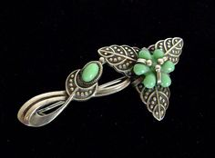 $34.99 STEAL this Luscious Sterling Silver Art Deco Brooch! Flowing contours are flirty, feminine and powerful... Rich turquoise glass cab and floral embellishments add a tough of dramatic whimsy... perfect gift idea!!