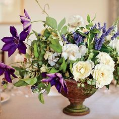 Lavender mixed with white garden roses and rich purple clematis.  Some possible elements for your bouquet if these blooms are in season.