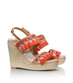 Tory Burch orange tassle wedge shoe