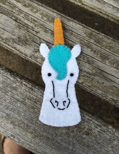 A fancy blue-haired unicorn. A perfect addition to any fantasy adventure. Handsewn with embroidered details. Made from an original design in felt with all stitching and edging done in embroidery floss Felt Puppets, Felt Finger Puppets, Hand Puppets, Puppet Crafts, Felt Crafts, Finger Puppet Patterns, Marionette, Crafts For Kids To Make, Felt Fabric