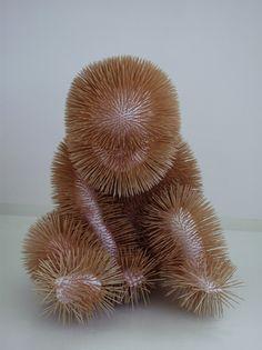 Dutch artist Sabi van Hemert creates sculptures of figures that combine childlike poses with alien looks.